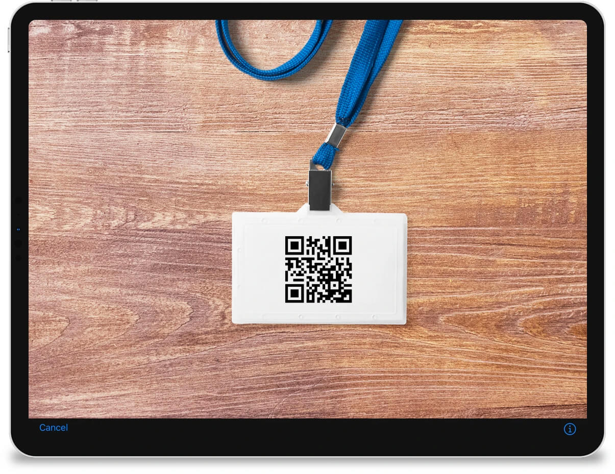 An iPad showing the native camera interface which is scanning a QR code from an ID badge.