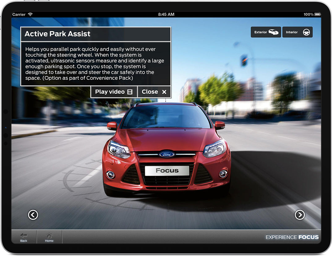 An iPad displaying a prompt to watch a video about the Ford Focus.