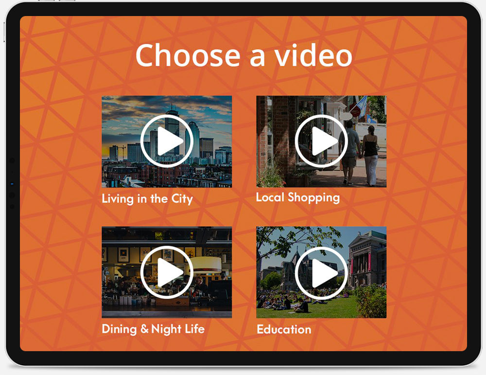 An iPad displaying a menu of video thumbnails.