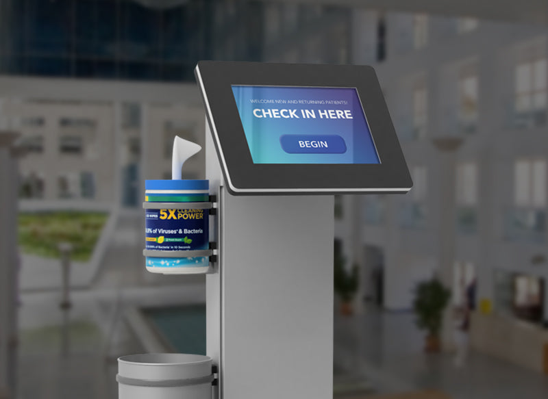 A free standing kiosk with a sanitation wipe holder and trash bin.