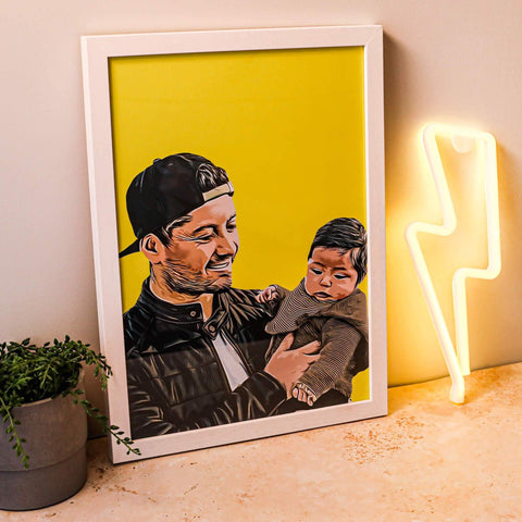 yellow poster of dad carrying his baby or son in a frame beside a plant and lightning light deco