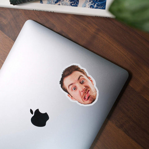 personalised face photo sticker on apple laptop on wooden office desk