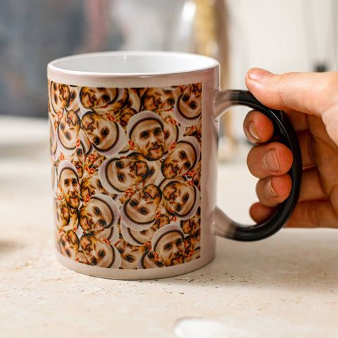 hand holding a Personalised Many Face Heat Change Mug with faces of a guy