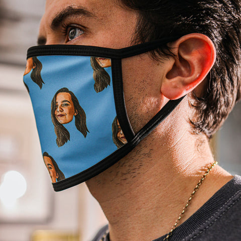 Handsome man wearing a blue personalised face mask