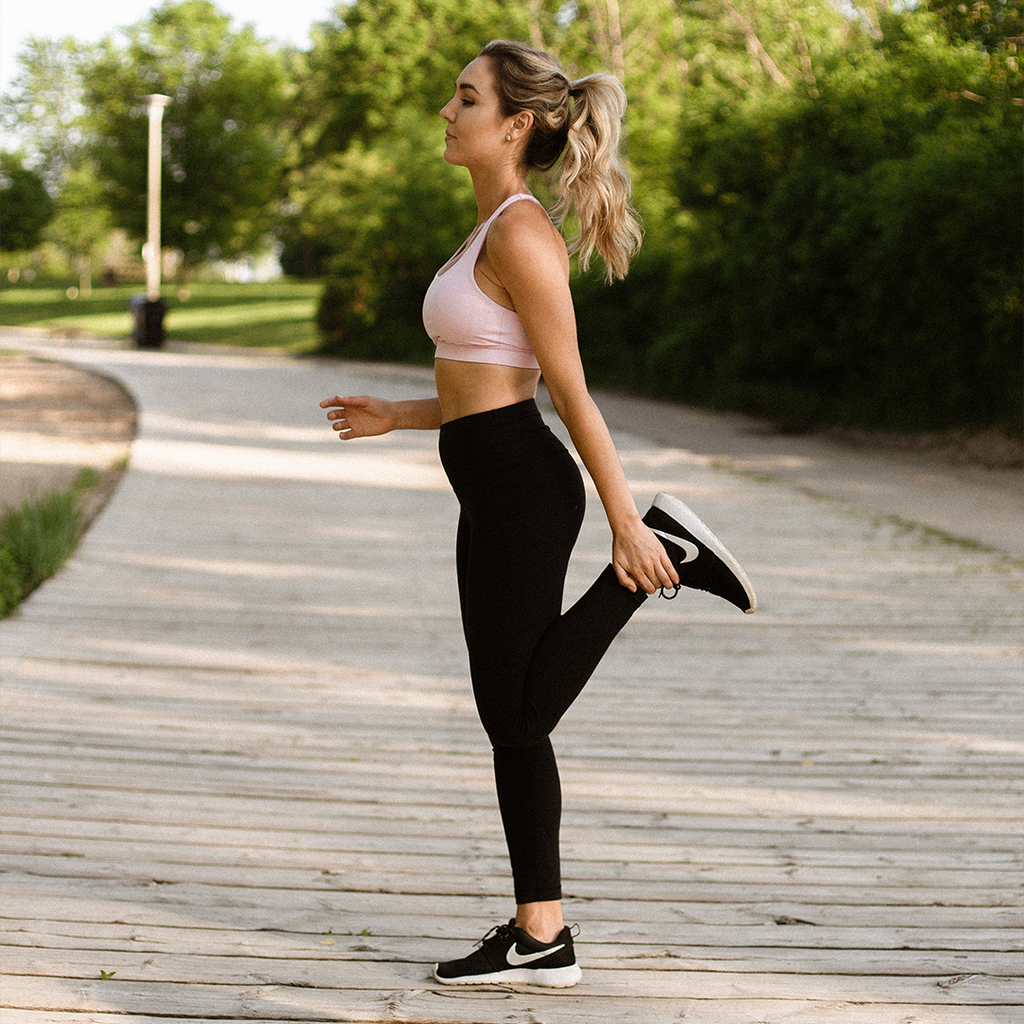 Girl stretching outside