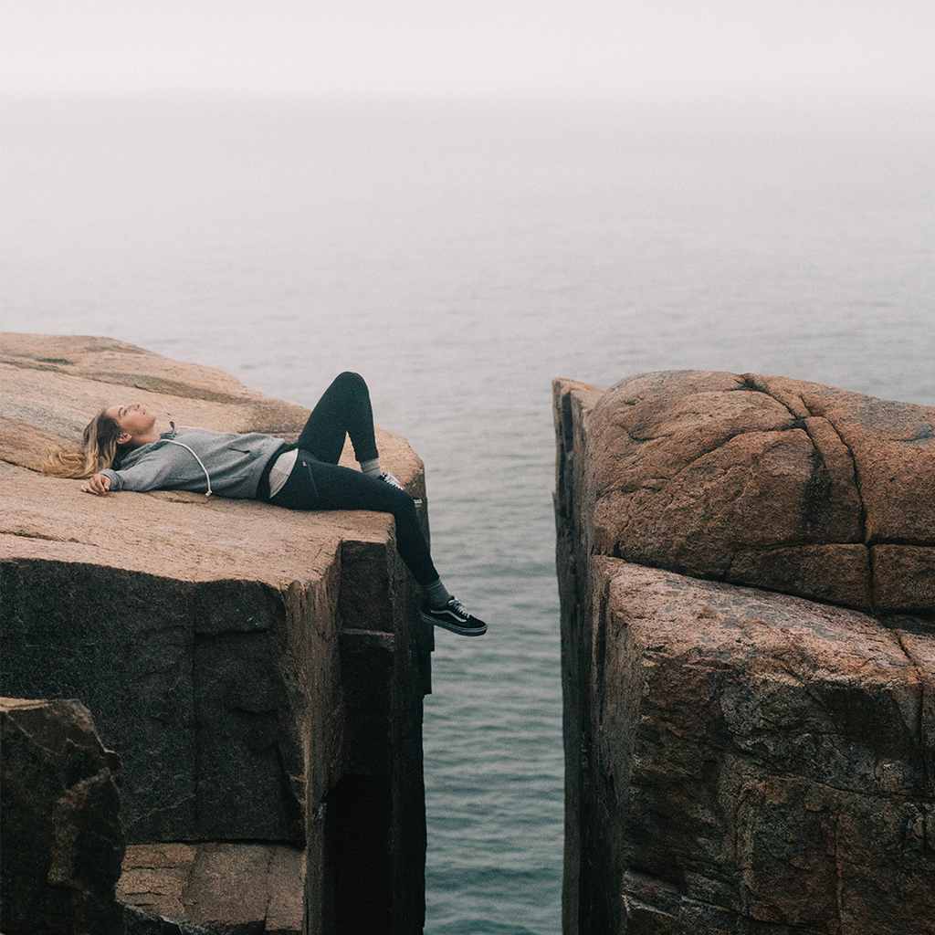 Woman laying on a rock