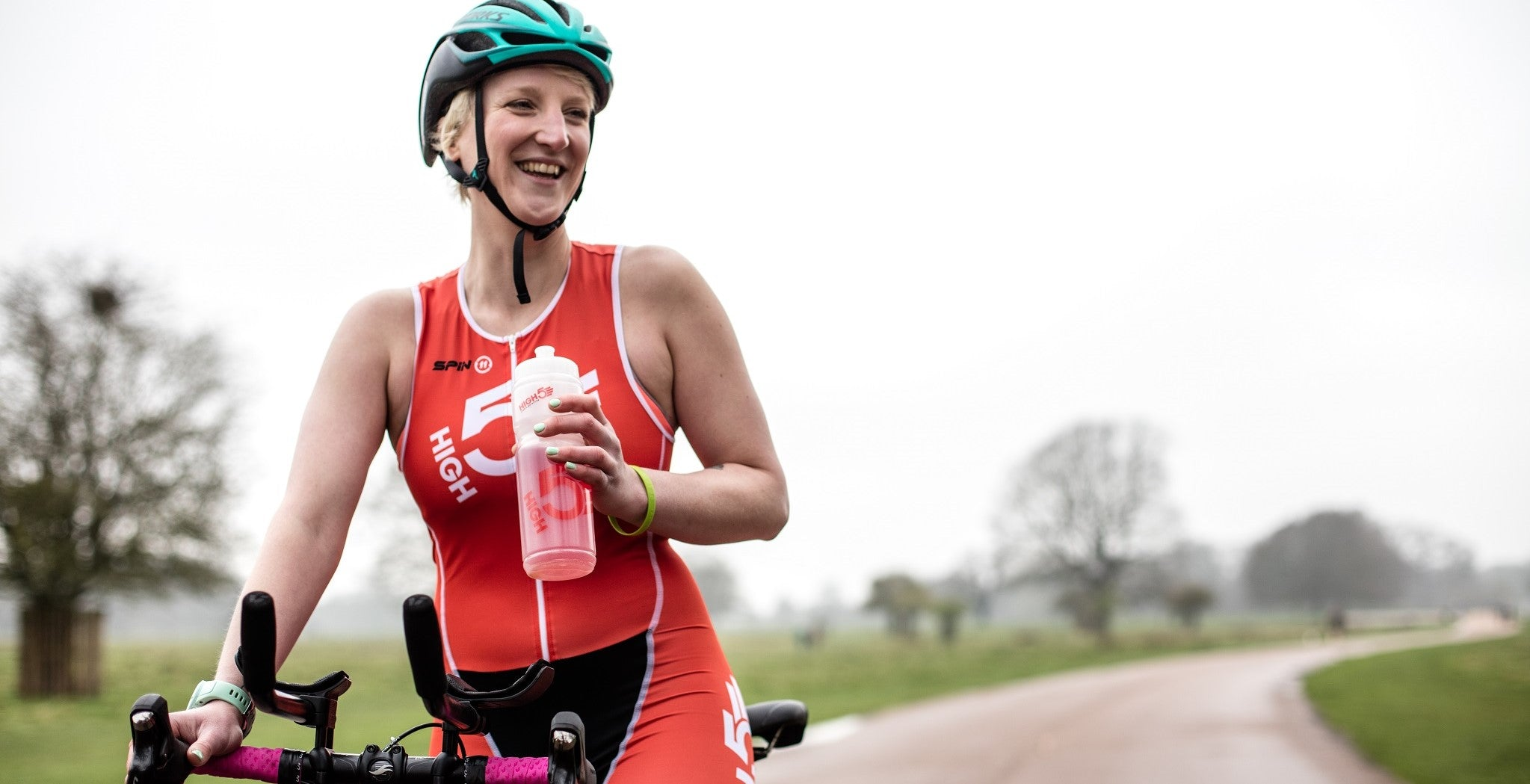 Cyclist drinking HIGH5 Energy Drink