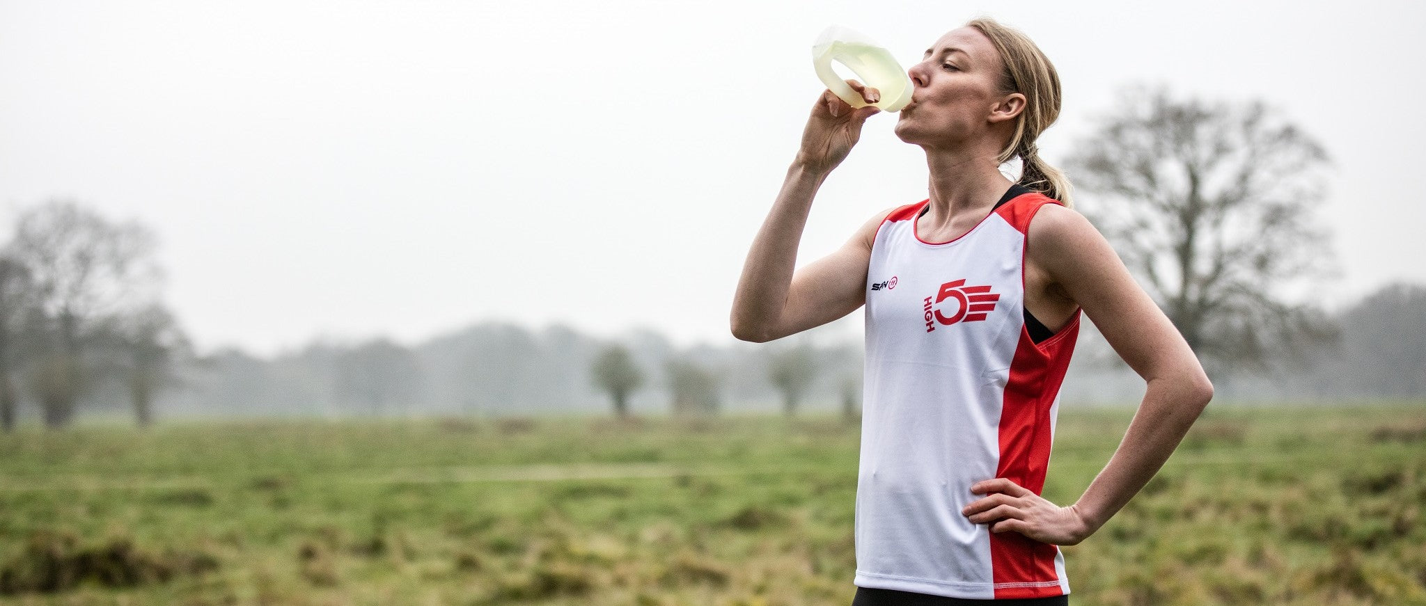 Runner drinking from HIGH5 bottle