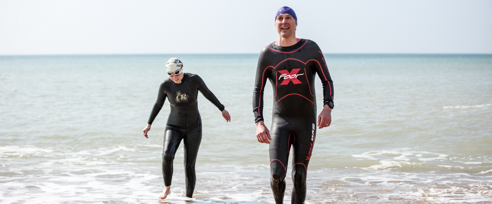 Two triathletes leave the sea