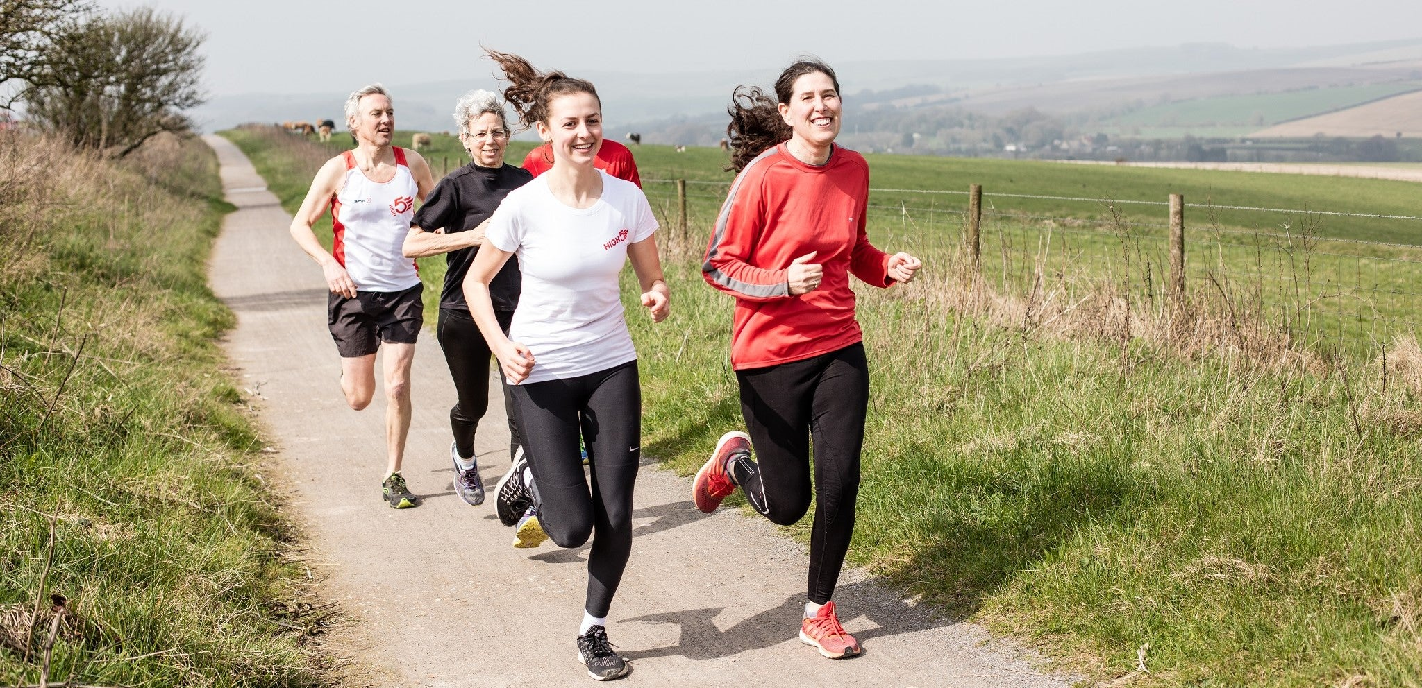 People running in the countryside