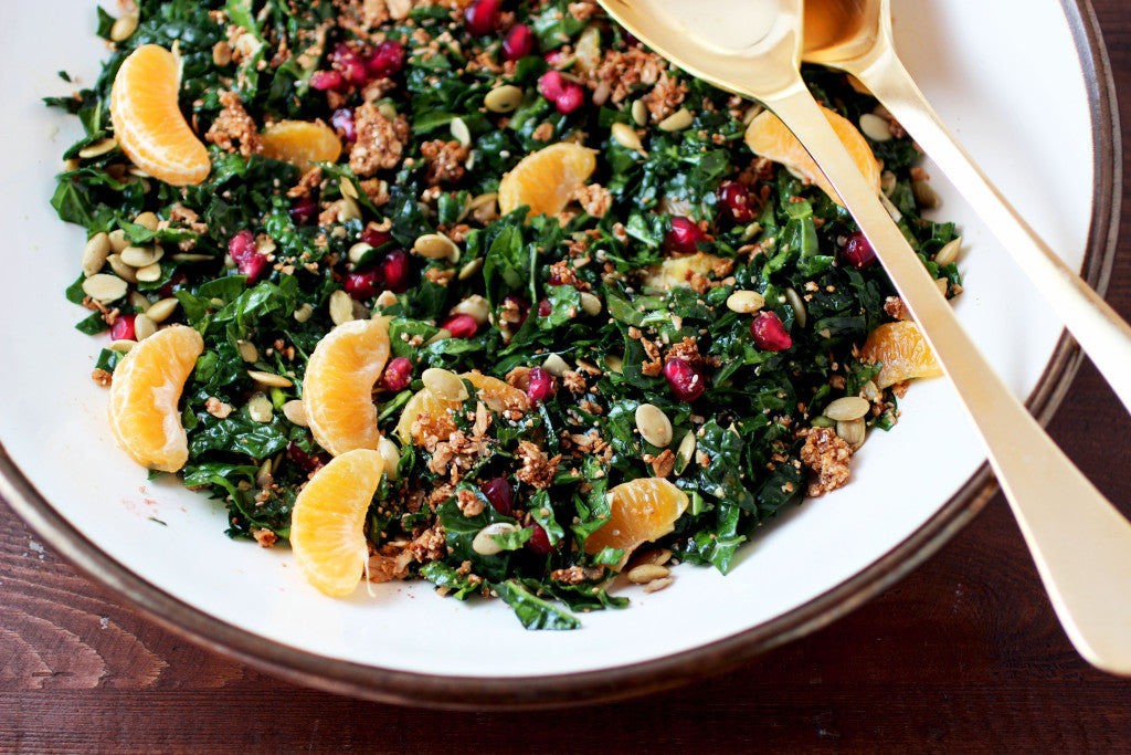 Kale Salad With Pomegranates, Clementines, Pumpkin Seeds + Granola