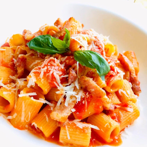 pasta amatriciana, tomato sauce, pancetta and pecorino cheese. heritage recipe from rome