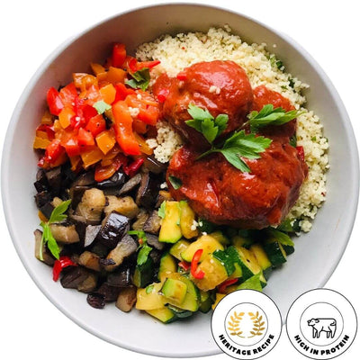 Italian red meatballs, Tender lean meatballs cooked in a mildly spicy tomato sauce, here served with couscous and mixed vegetables caponata.