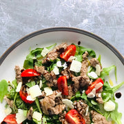 Italian Rump steak straccetti salad, very popular in Italy for its simplicity lightness and taste, made of pan-fried lean beef strips, cherry tomatoes, Parmigiano shaves, balsamic vinegar and of course extra virgin olive oil.