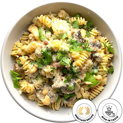 Creamy and delicious egg fusilli pasta prepared with mushrooms, garden peas, pancetta and parmesan cheese. Traditional recipe from Tuscany