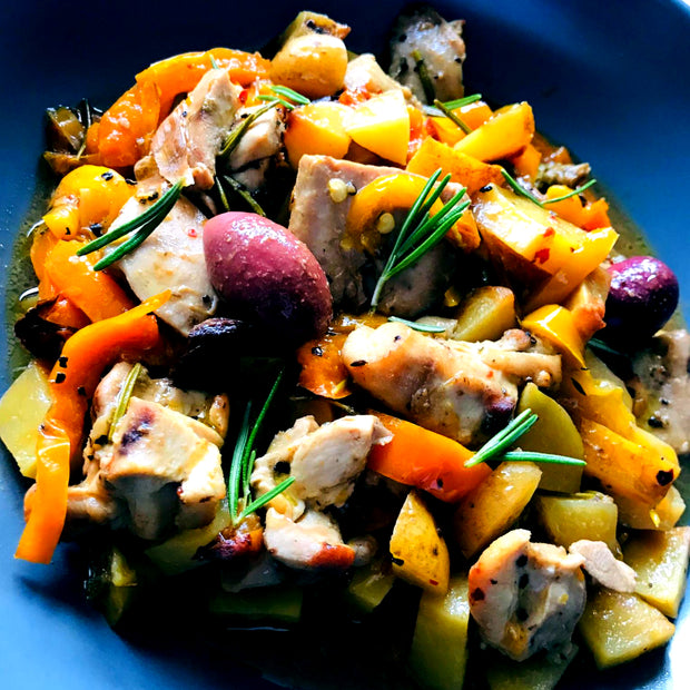 Italian traditional oven-baked chicken and potato roast, garnished with, peppers, carrots, greek olives and capers. In our healthy version, rich in lean protein, low in carbs and fat.