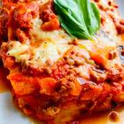 Traditional Italian healthy lasagna. A rich low-fat beef mince ragù, perfectly balanced with a gluten-free béchamel, soft mozzarella, basil, whole-wheat pasta, and parmesan.