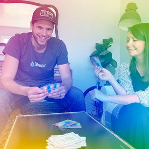 A man and woman sitting around a table playing the Enneagame