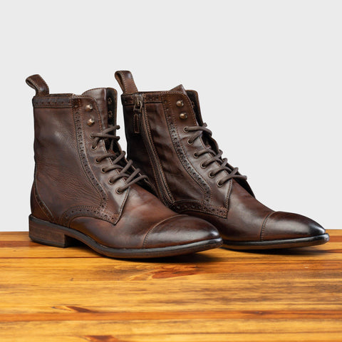 Pair of 7149 Calzoleria Toscana Women's Brown Dip-Dyed Diver Combat Boot on top of a wooden table