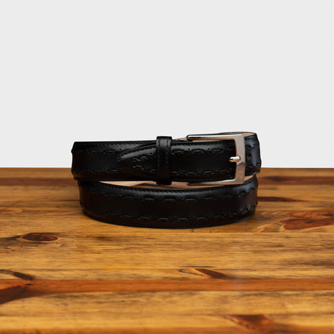 Picture of C1482 Calzoleria Toscana Black Stitched Dress Belt curled up on top of a wooden table
