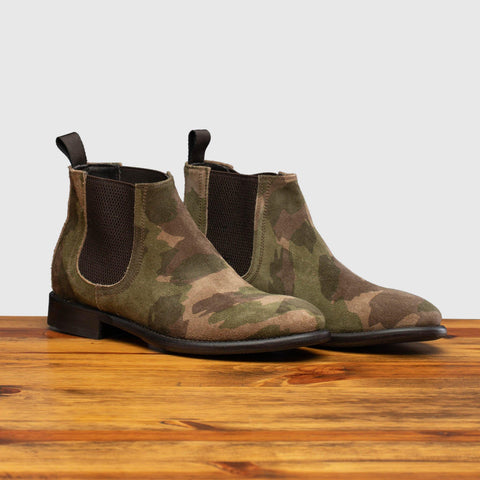 Pair of D681 Calzoleria Toscana Posta Donna Boot in Camoflauge on top of a wooden table