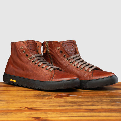 Pair of H883 Calzoleria Toscana Coker High Top Benso Sneaker on top of a wooden table