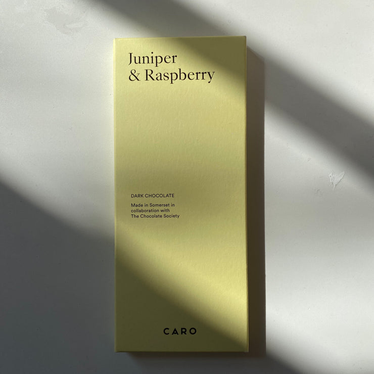CARO x The Chocolate Society in Juniper & Raspberry Dark Bar
