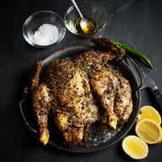 Za'atar seasoned whole grilling chicken