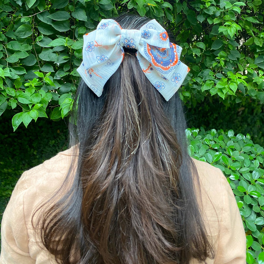 white bow with multi print