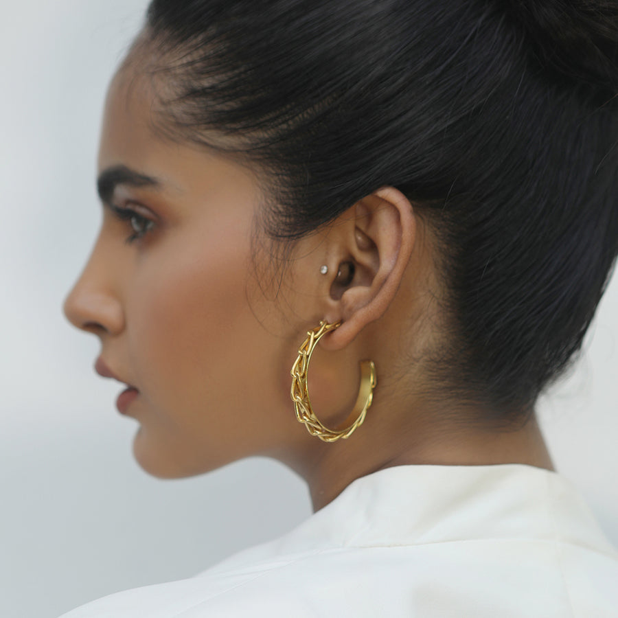 gold hoops on model