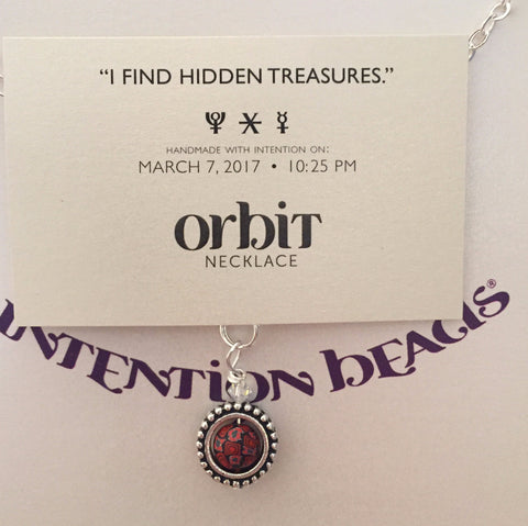 Orbit Necklace: I find hidden treasures.
