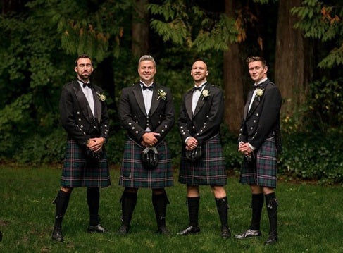 The groom and groomsmen wear a tux with the Scottish kilt