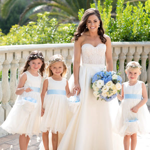 Bride with cute flower girls in light and airy Adelina dress by Ana Balahan