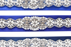 Beautiful rhinestone applique with blue satin ribbon closer view