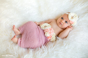 Newborn photo session for little baby girl in wrap wearing Fantasy floral set of belt and headband with gems and flowers