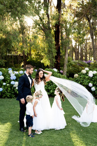 Bride and groom with page boy and flower girls in Grace flower girl dresses Ana Balahan