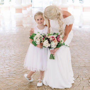 Adelina dress Ana Balahan Bride hugging flower girl wearing white color flower girl dress