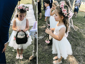 Adelina dress Ana Balahan Girl in ivory color dress with flower wreath and petal basket