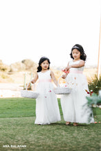 Load image into Gallery viewer, Two flower girls walking down the aisle throwing petals