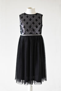 Anna Black seqiun dress with pleasted skirt front view Ana Blahan