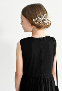 Anna black sequin dress with pleated skirt and crossbody bag back view Ana Balahan