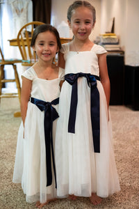 Annabelle dress Ana Balahan two pretty girls in floor length dresses with navy color belts
