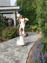 Load image into Gallery viewer, Bride and little flower girl with their flowers