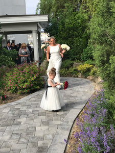 Bride and little flower girl with their flowers