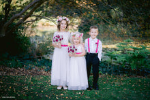 Load image into Gallery viewer, Two junior bridesmaids in their long dresses with lace tops and floral summer rose wreaths and page boy wearing matching accessories.