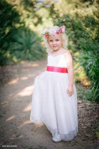 Little girl in off-white color dress with flower whreat Ana Balahan