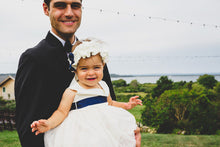 Load image into Gallery viewer, Dad holding little cute girl in Adelina dress