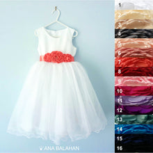 Load image into Gallery viewer, Ranunculus flower sash on a fantastic Adelina dress