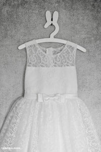 Gorgeous white communion attire with big bow on the back front view