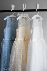 Three high quality girl dresses in blue cream and white colors front view